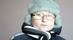 Boy in winter clothes looking at the camera Stock Footage