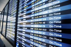 Info of flight on billboard in airport Stock Photos