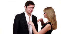 Couple in formal evening wear are getting dressed for an evening out 4K Stock Footage