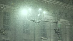 Heavy Snowfall in slow motion under street lamps Stock Footage