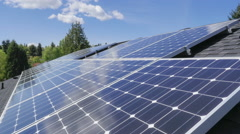 Time lapse of clouds reflecting in solar panels Stock Footage