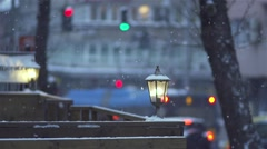 Snow is falling in slow motion on a city street with believers and bus - stock footage