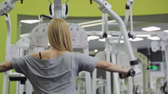 A athlete, blonde women with muscular body doing exercise on the back and Stock Footage