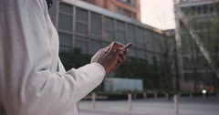 African American businessman through city using smart phone Stock Footage