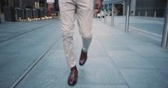 African American businessman walking through city using smart phone - stock footage
