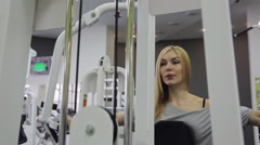 A athlete, blonde women with muscular body doing exercise on the chest straining Stock Footage