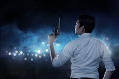 Secret Agent Holding Gun Stock Photos