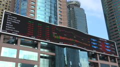 Financial ticker board displays global stock market indices in Shanghai, China Stock Footage
