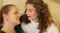 Mother and daughter are intimate conversation. - stock footage