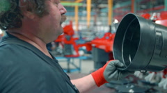 Putting a safety equipment on a tool Stock Footage