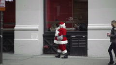 Sad Santa Claus man in costume walking New York City street slow motion 1080 HD Stock Footage