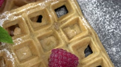 Stock Video Footage of Fresh made Waffles with Raspberries (seamless loopable, 4K)