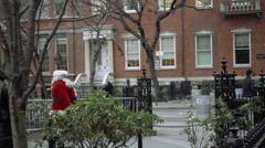 man dressed in Santa Claus costume walking in public park in NYC 1080 HD - stock footage