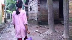 Girl brings home rice to her simple home in india Stock Footage