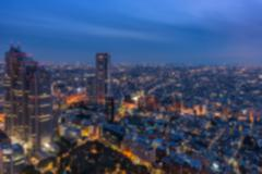 Blurred background of night view in a metropolis - stock photo