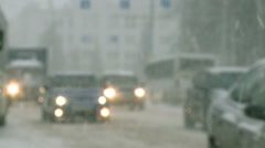 Cars driving in the city during a snowfall. Stock Footage