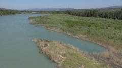 Along the banks of the River Durance by drone, Pertuis, France Stock Footage