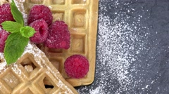 Portion of Waffles with Raspberries (not loopable, 4K) Stock Footage