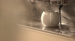 Water flows from coffee machine in slow motion Stock Footage