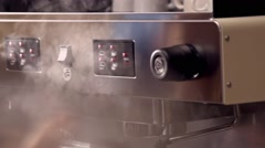 Steam from the coffee machine in slow motion Stock Footage