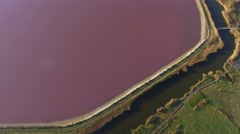 Aerial view of the Salins du Midi salt marshes, Aigues-Mortes, France – by drone Stock Footage