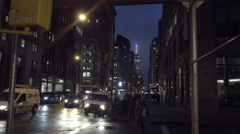 Stock Video Footage of 12th Street and 5th Ave zooming in on Empire State Building night beautiful NYC