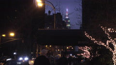 Stock Video Footage of colorful lights on Empire State Building from 5th Ave at night holidays NYC