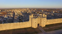 Medieval town of Aigues-Mortes, Camargue, Gard, France in the morning by drone - stock footage