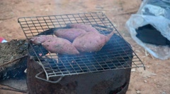 Burning sweet potato on old stove Stock Footage