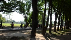 Thai student group travel and walking at Sukhothai Historical Park Stock Footage