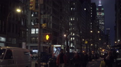 Suspicious creepy white man in black hood on 5th Avenue and 12th Street busy NYC Stock Footage