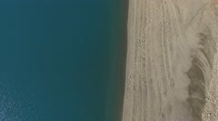 Shoreline of the Lac de Serre-Poncon lake and view, French Alps, France – aerial Stock Footage