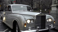 Rolls-Royce classic luxury car panning to Lower Fifth Avenue traffic, NYC - stock footage
