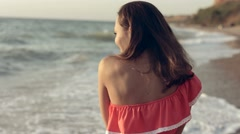 Seductive young woman come close to the water of the sea Stock Footage