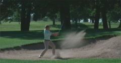 Golfer hits shot out of bunker. Stock Footage
