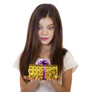 Stock Photo of Happy smiling little girl holding and offering a gift for Christmas and birth