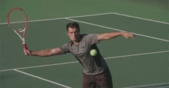 Tennis Player Runs Along Net and Volleys. Stock Footage