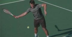 Tennis Player Volleys over Net. Stock Footage
