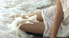 Sensual girl lying on the seashore - stock footage
