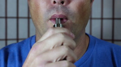Thirty some thing male using ecig Stock Footage