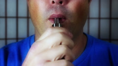 Color enhanced 30's male using Ecig Stock Footage