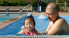 Little girl  have fun in swimming pool - stock footage