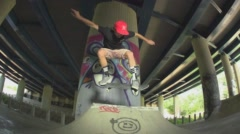 Skateboarder airs of ramp in Urban Enviroment. Stock Footage
