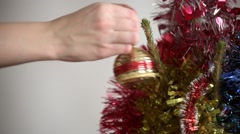 Decorating Christmas tree with a ball - stock footage