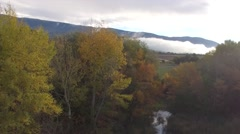 Autumn mist at a lake in the morning in the French countryside – aerial view by - stock footage