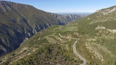 Road through the Gorges du Verdon gorge in autumn, France – aerial view by drone - stock footage