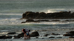 Father and child play on beach Stock Footage