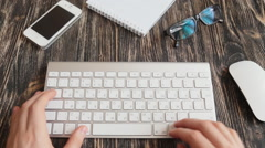 Workplace  glasses and note paper on wooden table - stock footage
