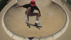 Skateboarder Airs out of Skatepark Bowl. Stock Footage