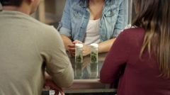 An associate at marijuana shop talking with customers about their purchase Stock Footage